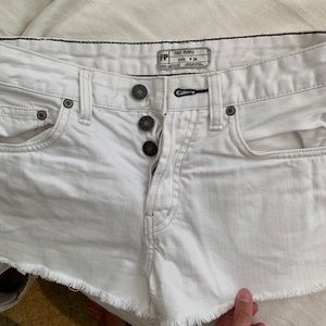 free people white jean shorts with distressed edge
